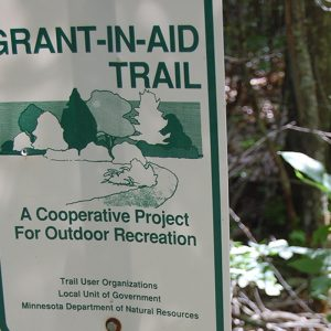 Grant-in-and-trail sign